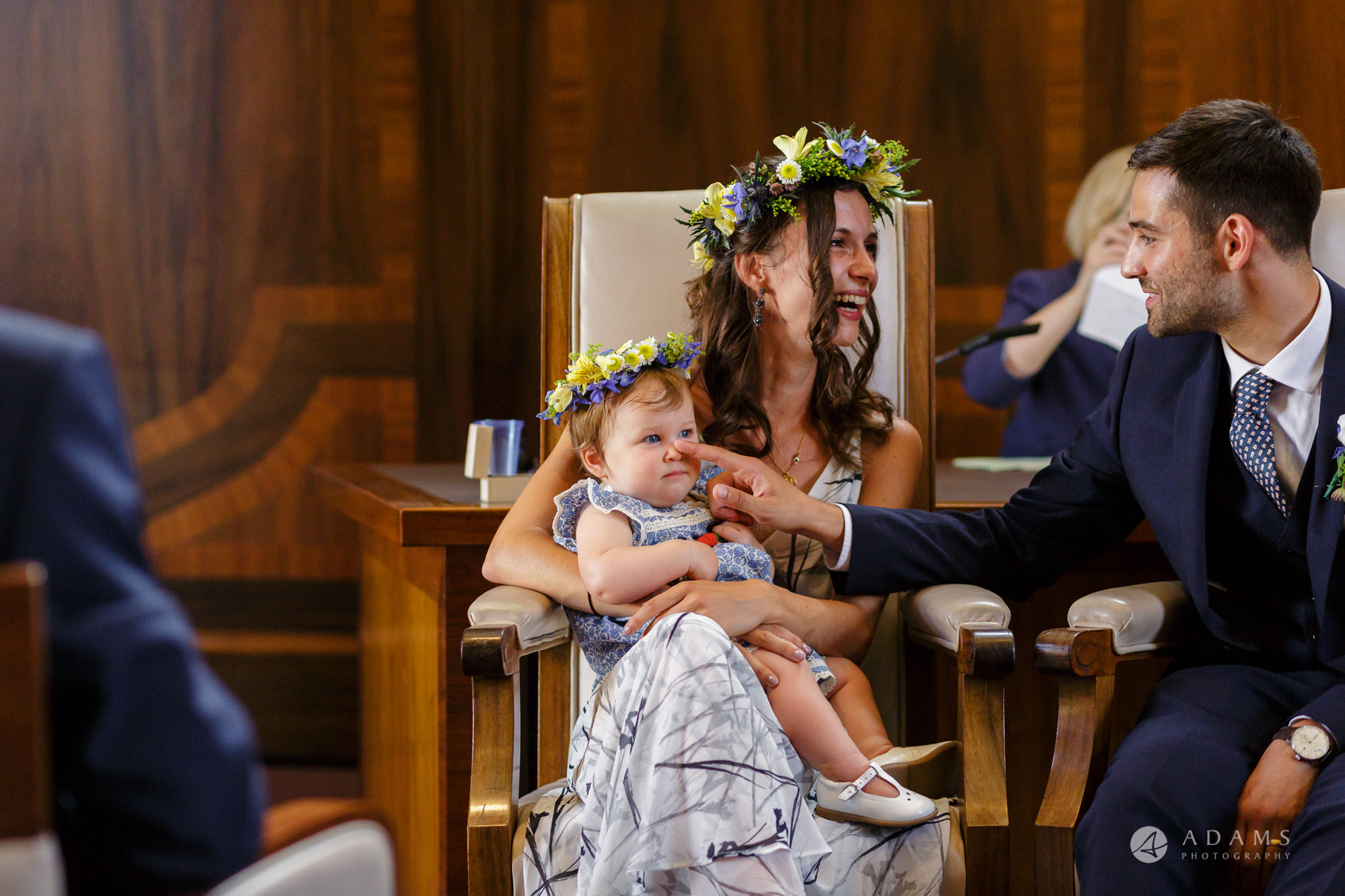 Clissold house wedding groom playing with the baby