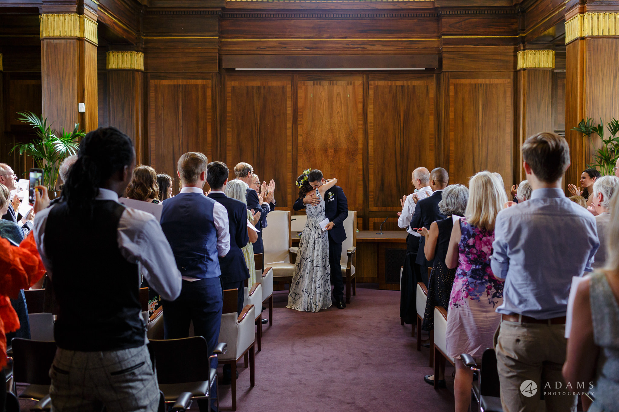 Clissold house wedding the couple hugs each other