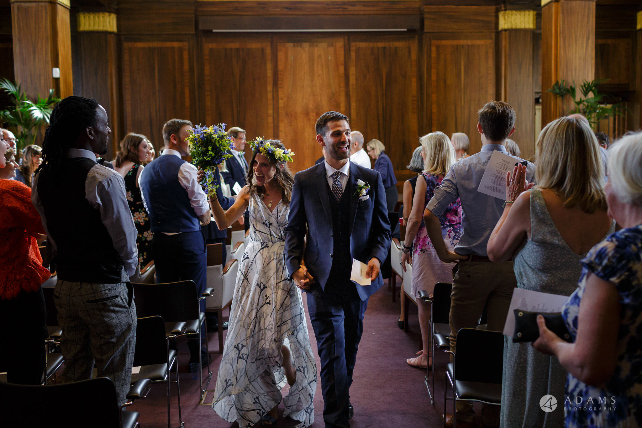 Clissold house wedding the married couple leaving the ceremony room