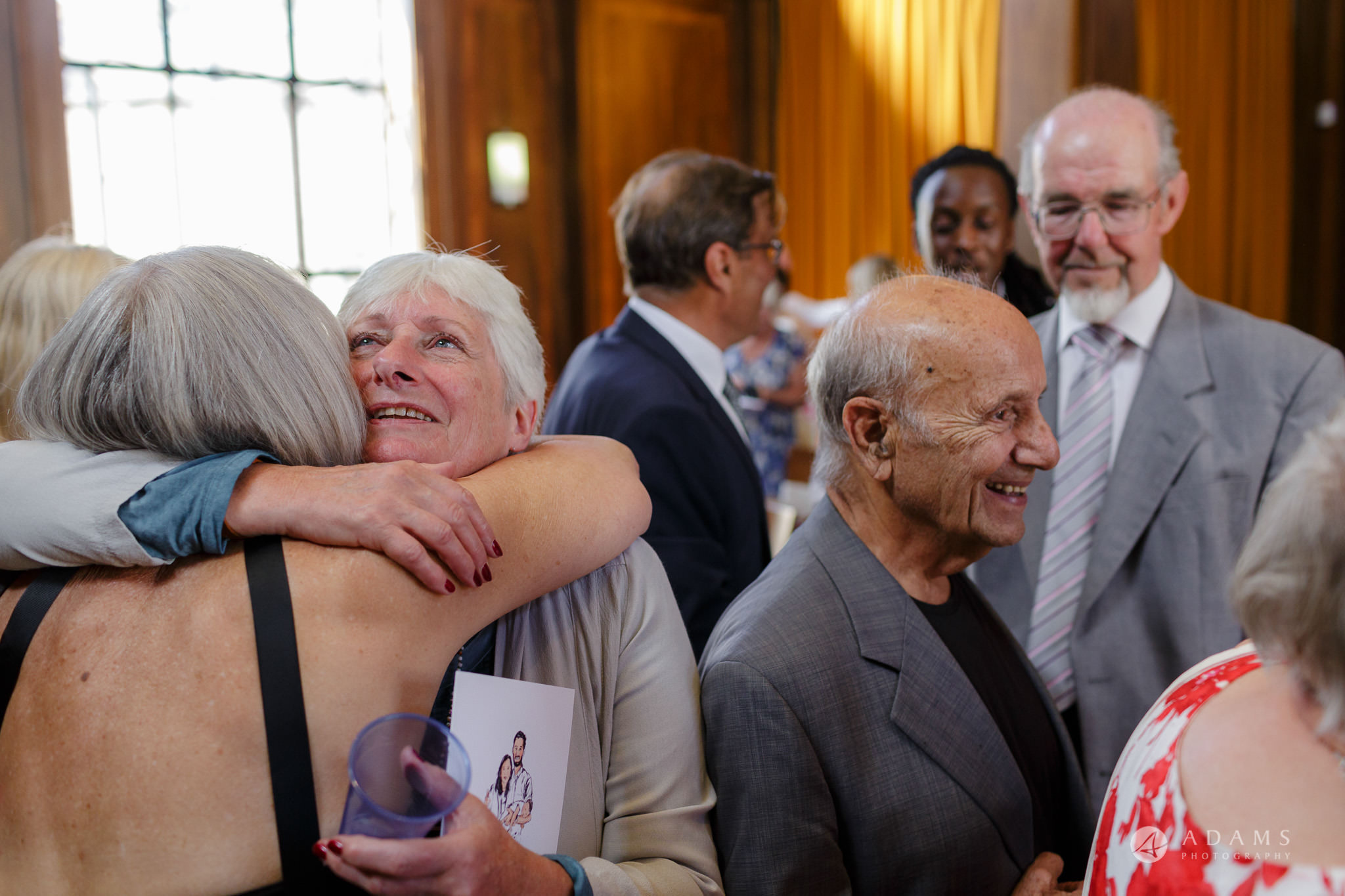 Clissold house wedding family hugs each other