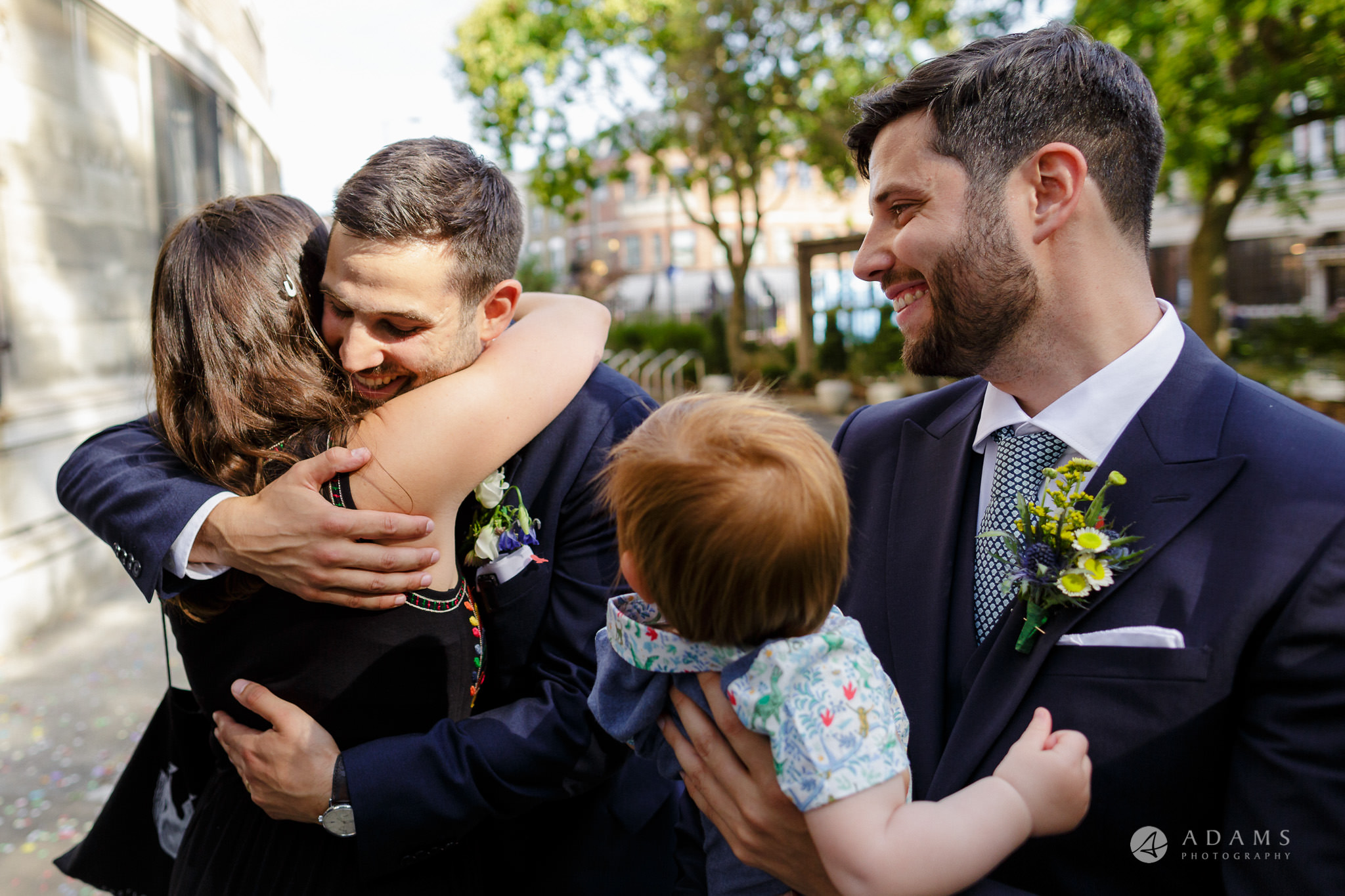 Clissold house wedding groom hugs a friend