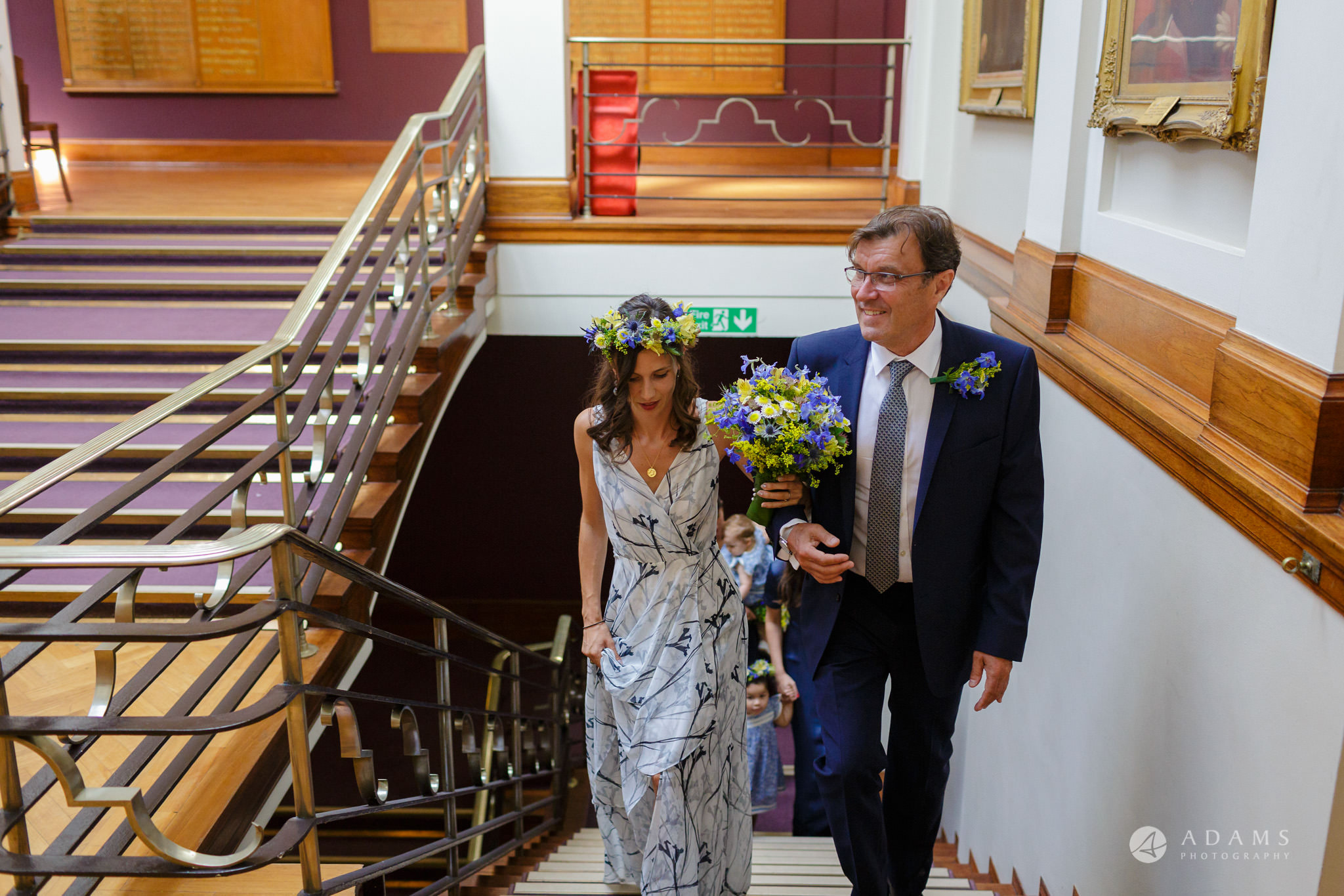 Clissold house wedding bride walking up the stairs with her father