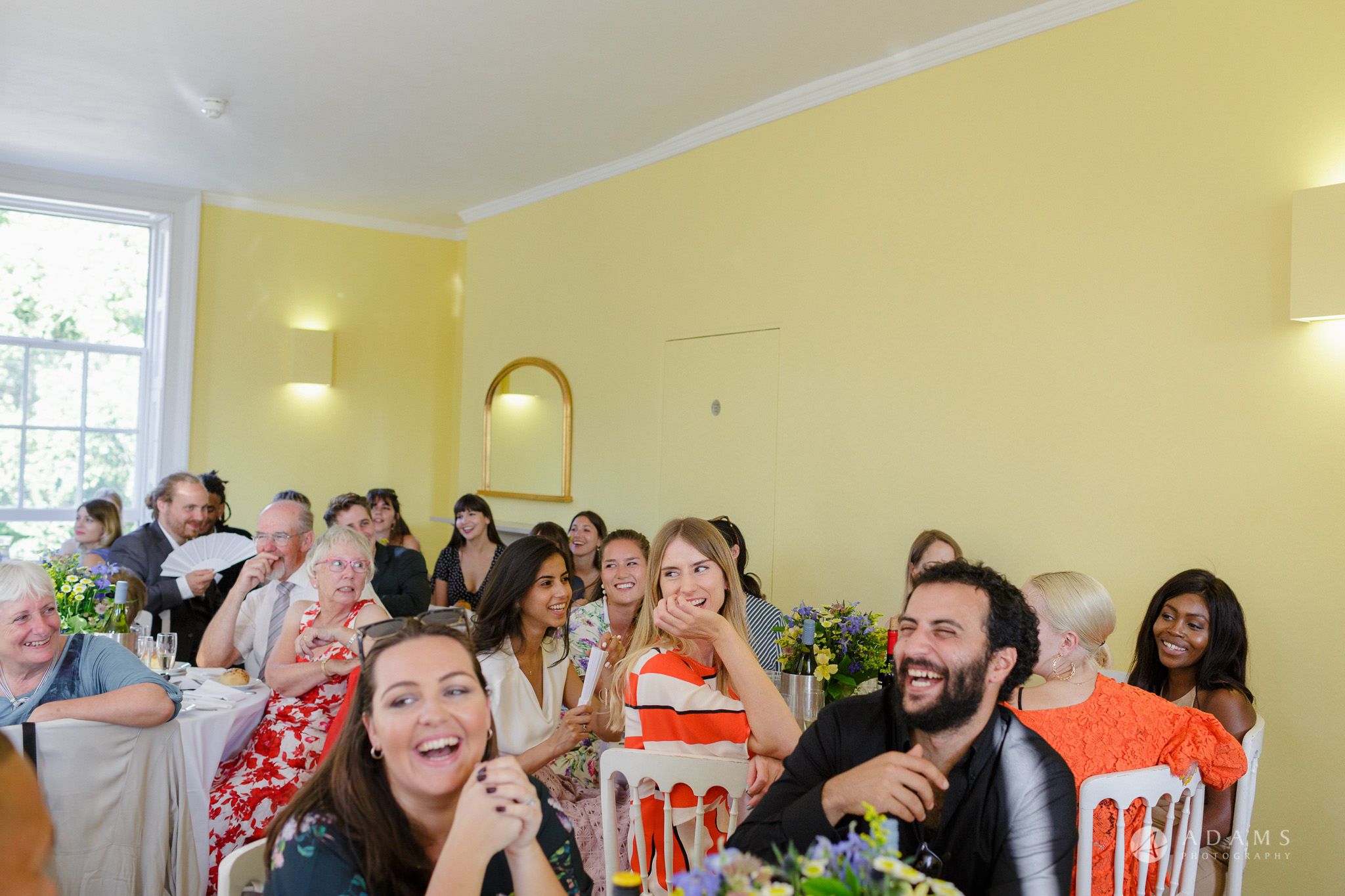 Clissold house wedding guests laughing during the speeches
