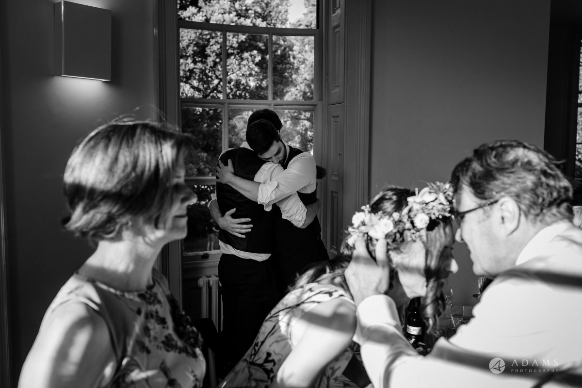 Clissold house wedding groom hugging his best man