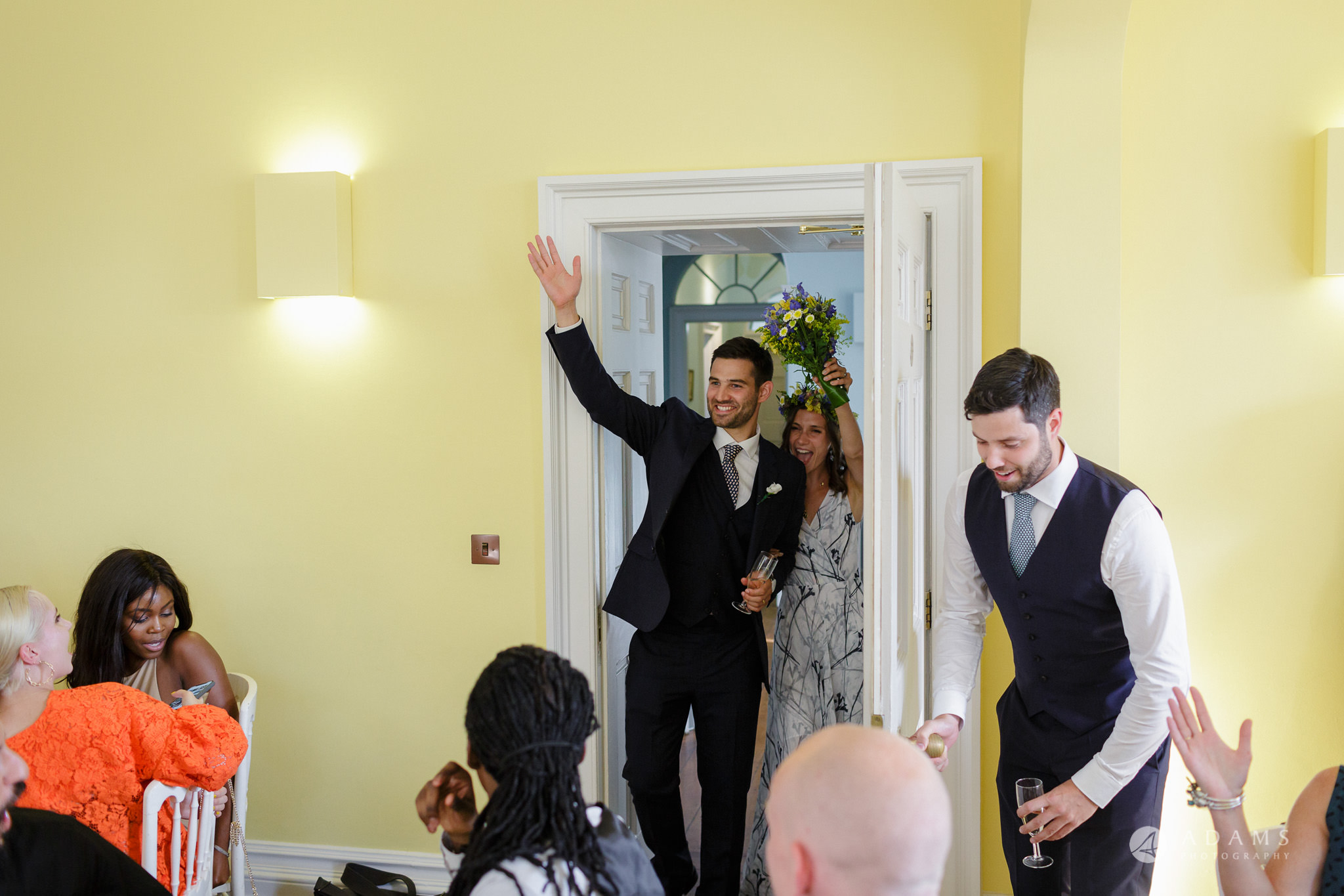 Clissold house wedding the bride and groom enter the wedding breakfast room