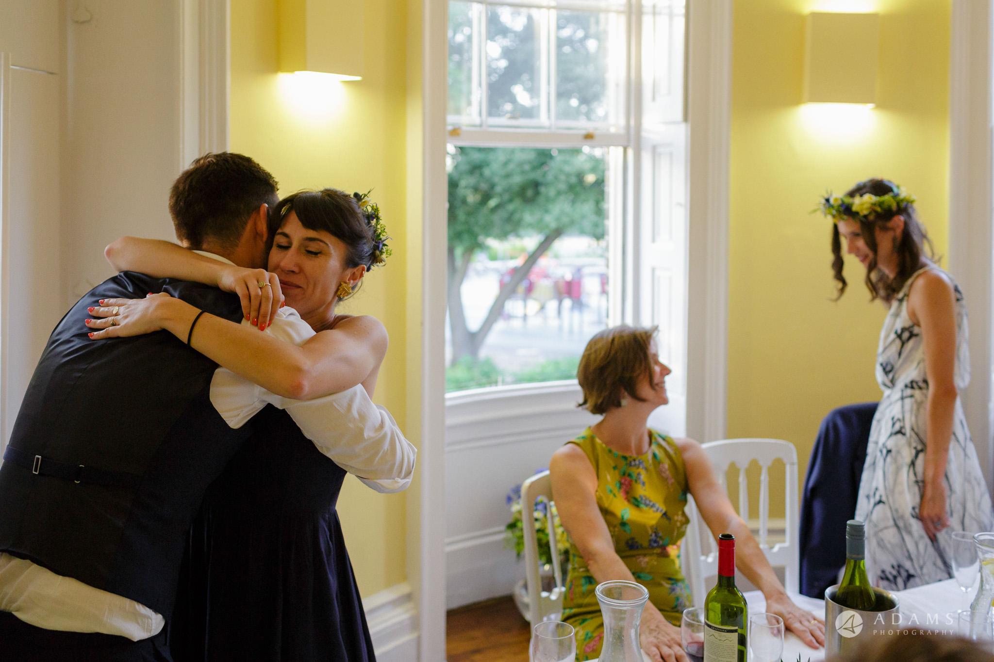 Clissold house wedding sister of the groom hugs him