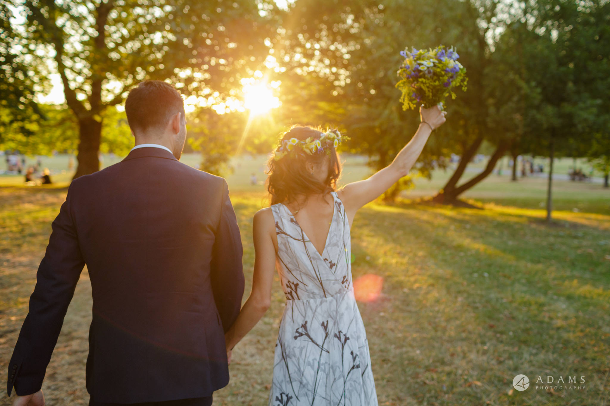 Clissold house wedding married couple walking towards the sun