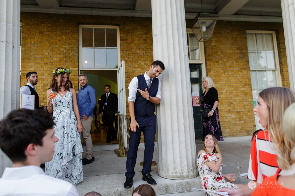 Clissold house wedding groom invites the guests inside