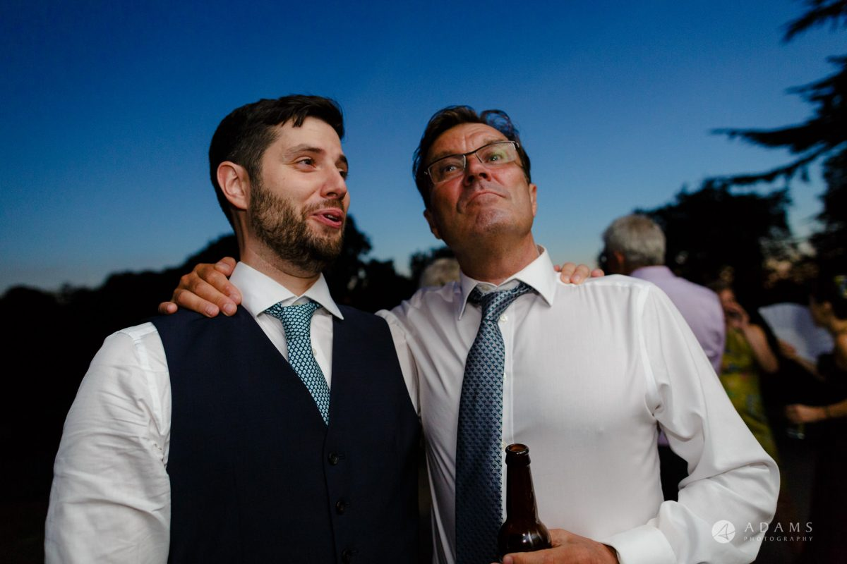 Clissold house wedding father and his son drinking beer