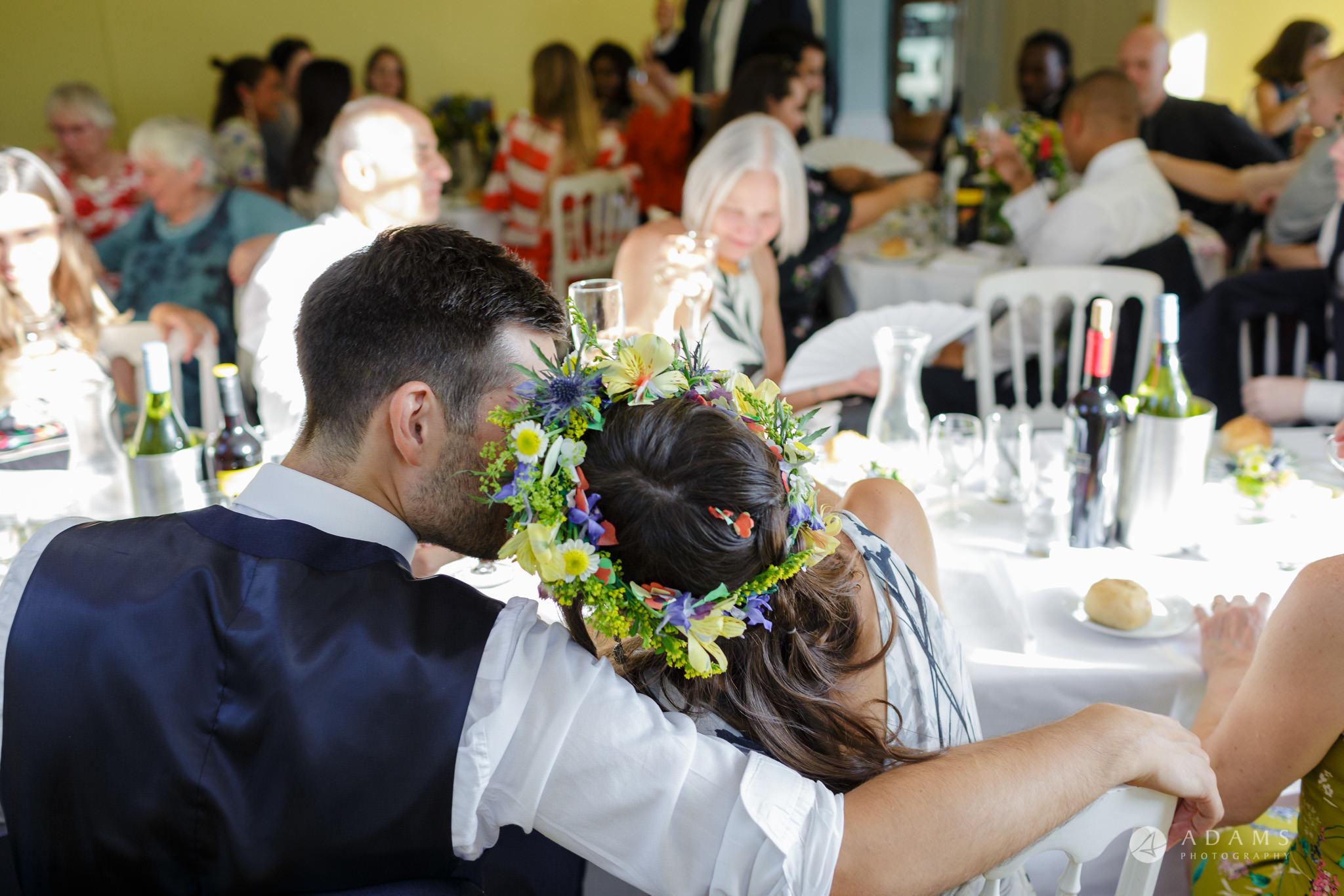 Clissold house wedding groom cuddles the bride