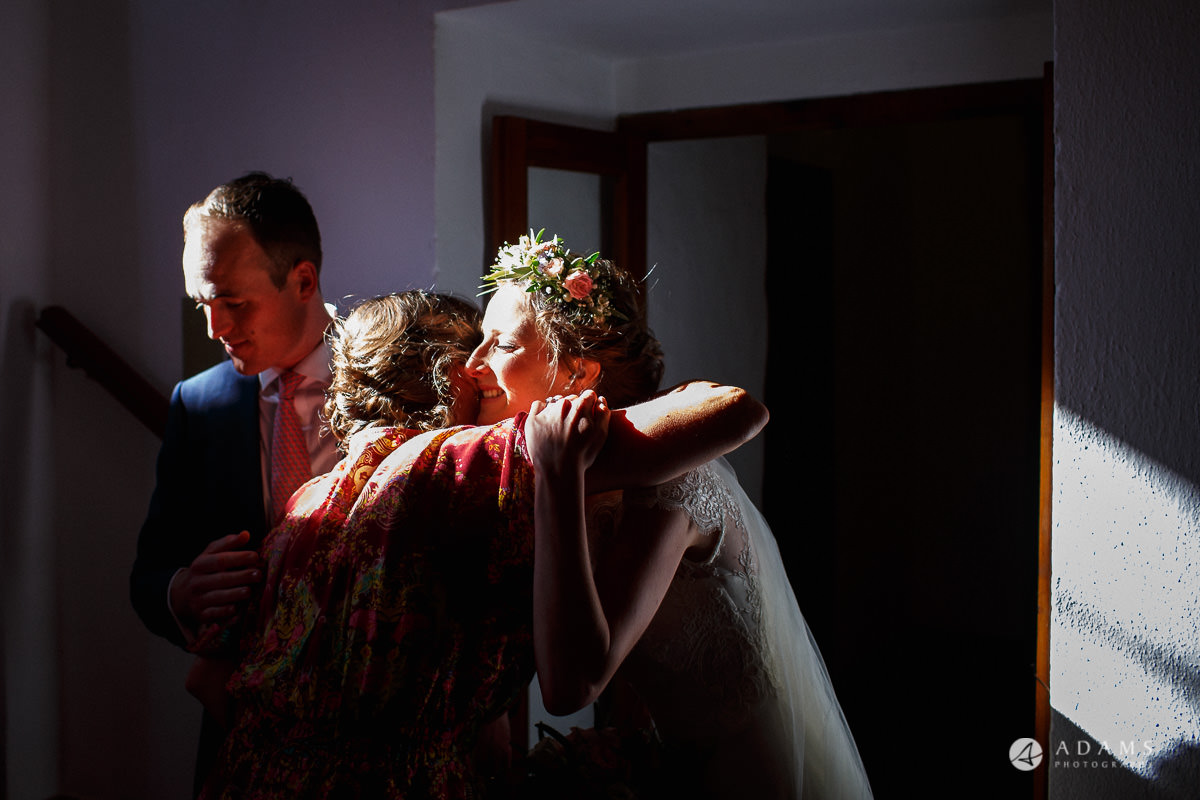 Destination Spain Wedding photos bride and groom hugged by their parents