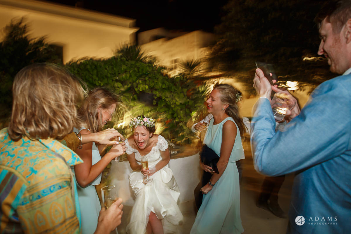 Destination Wedding Photographer bride and bridesmaids dancing and laughing