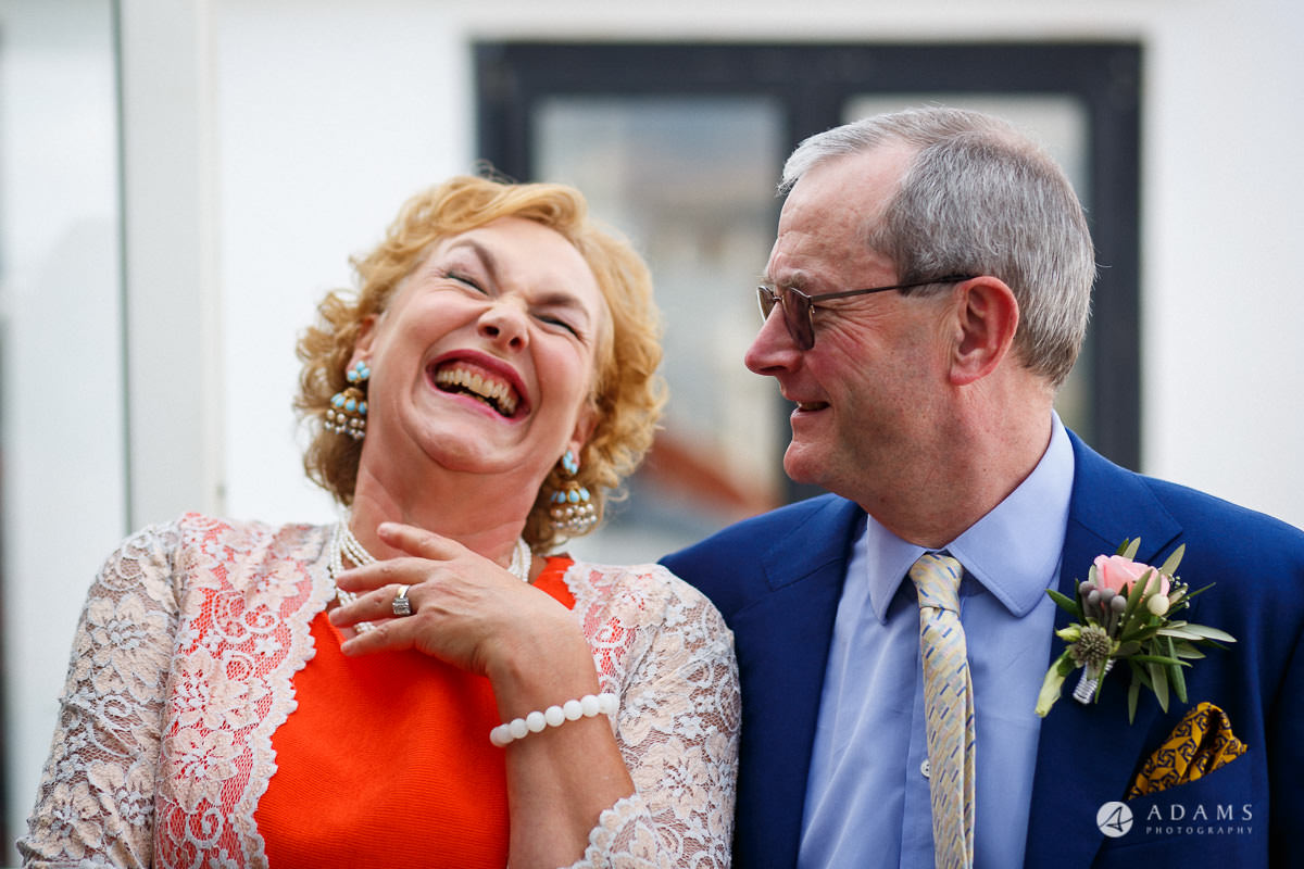 Spain Wedding Photographer mother and father of the bride laughing