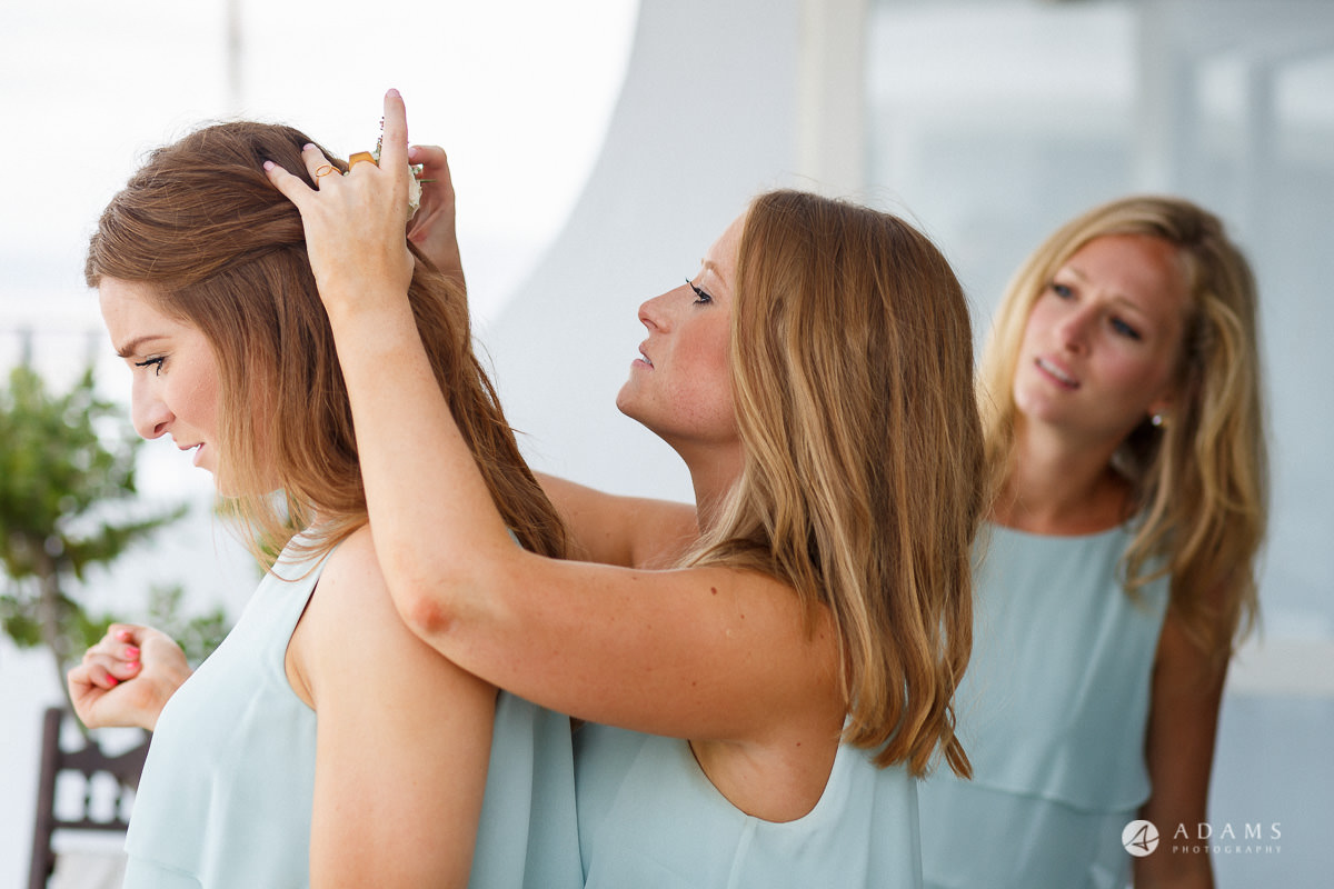 Spain Wedding Photographer bridesmaids playing with hair