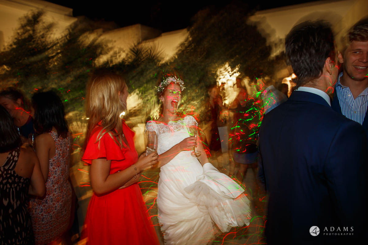 Destination Wedding Photographer bride dances party