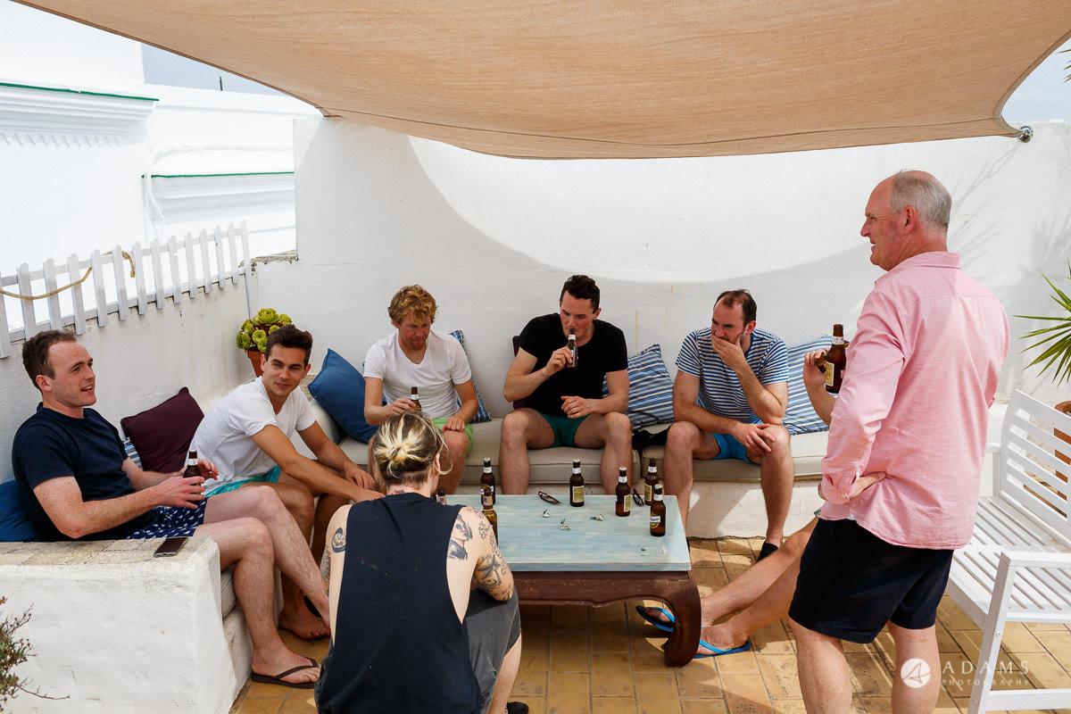 Wedding Photographer Spain groom and his groomsmen having beer