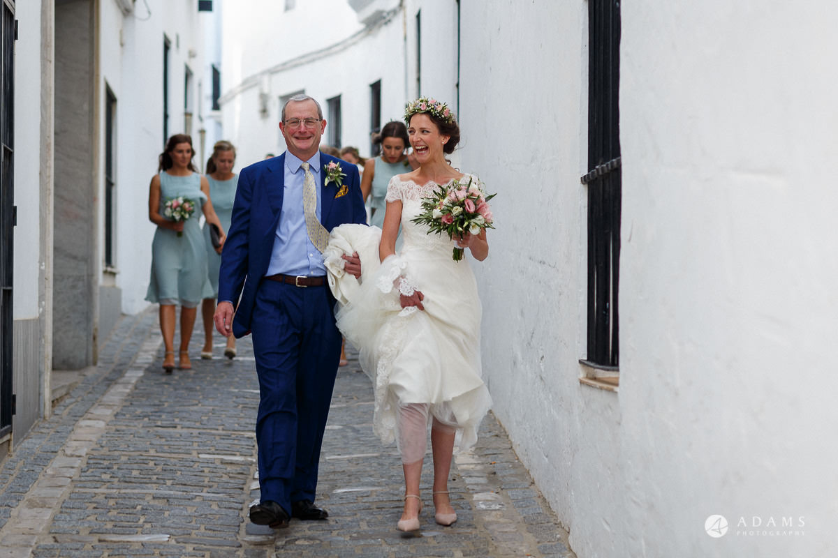 Destination Spain Wedding photos bride and her father walking