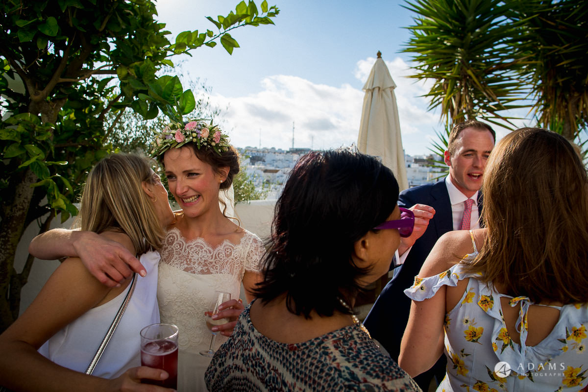 Destination Spain Wedding married couple hugs their guests