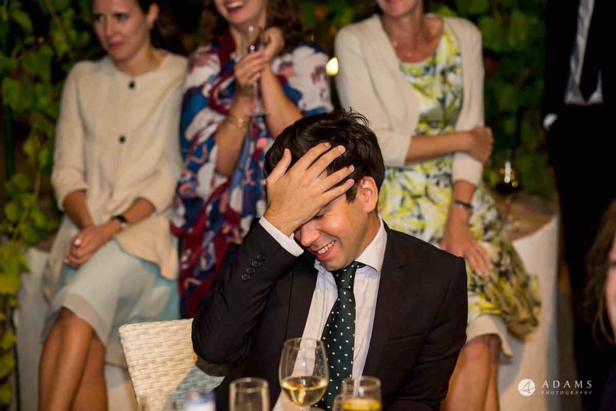 Spain Wedding Photographer guest hod his hand on his head