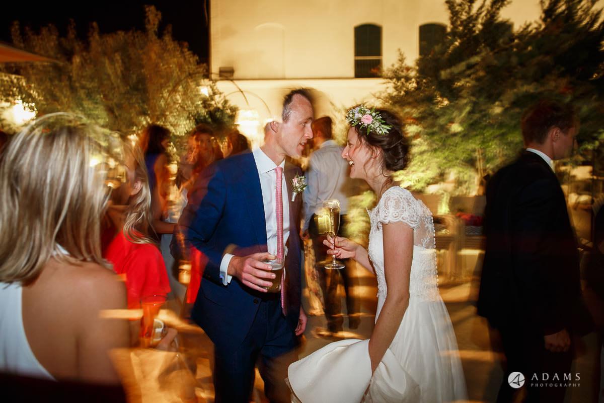Destination Wedding Photographer groom speaks with bride