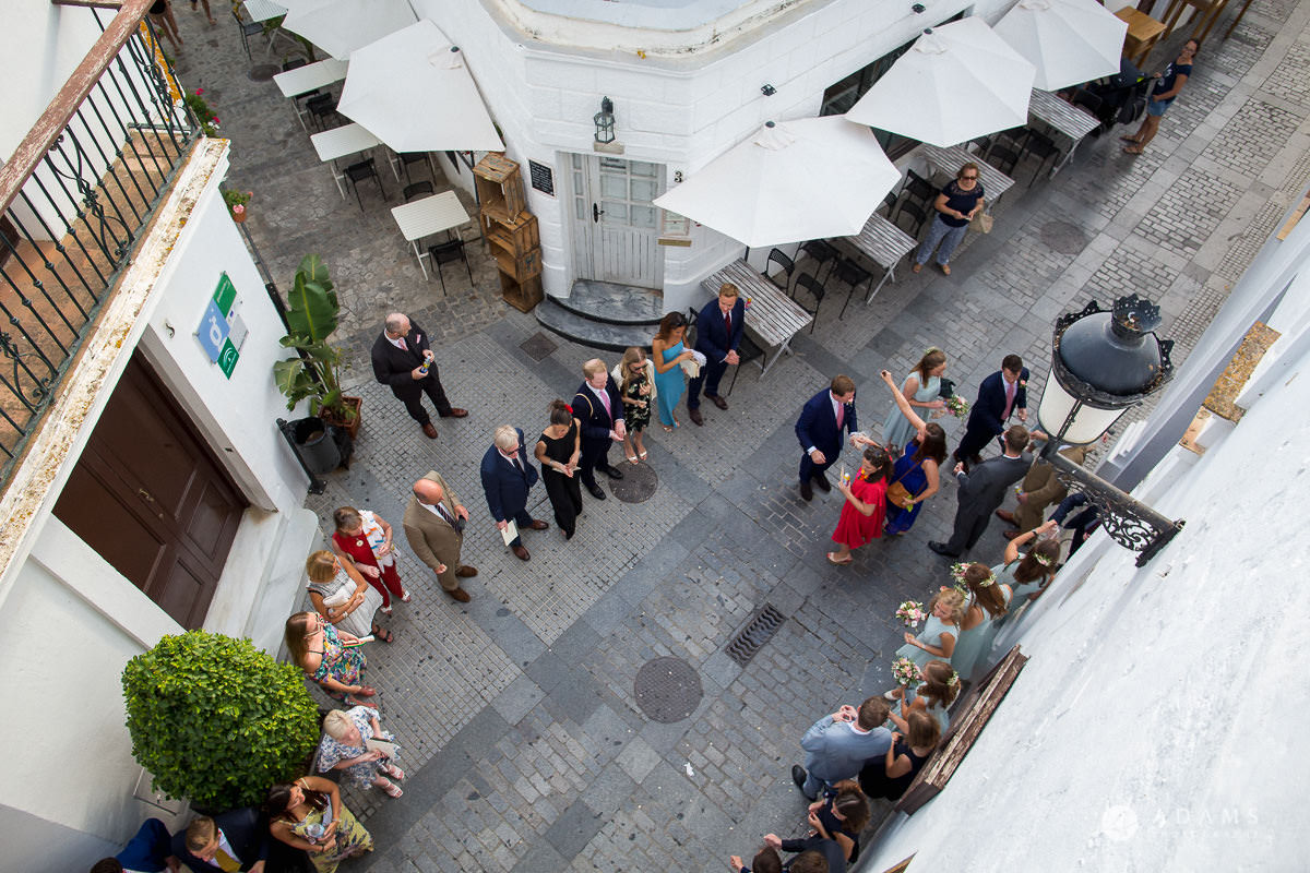 Destination Spain Wedding photos guests are waiting for the married caouple