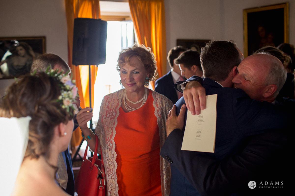 Destination Spain Wedding photos guest hugging