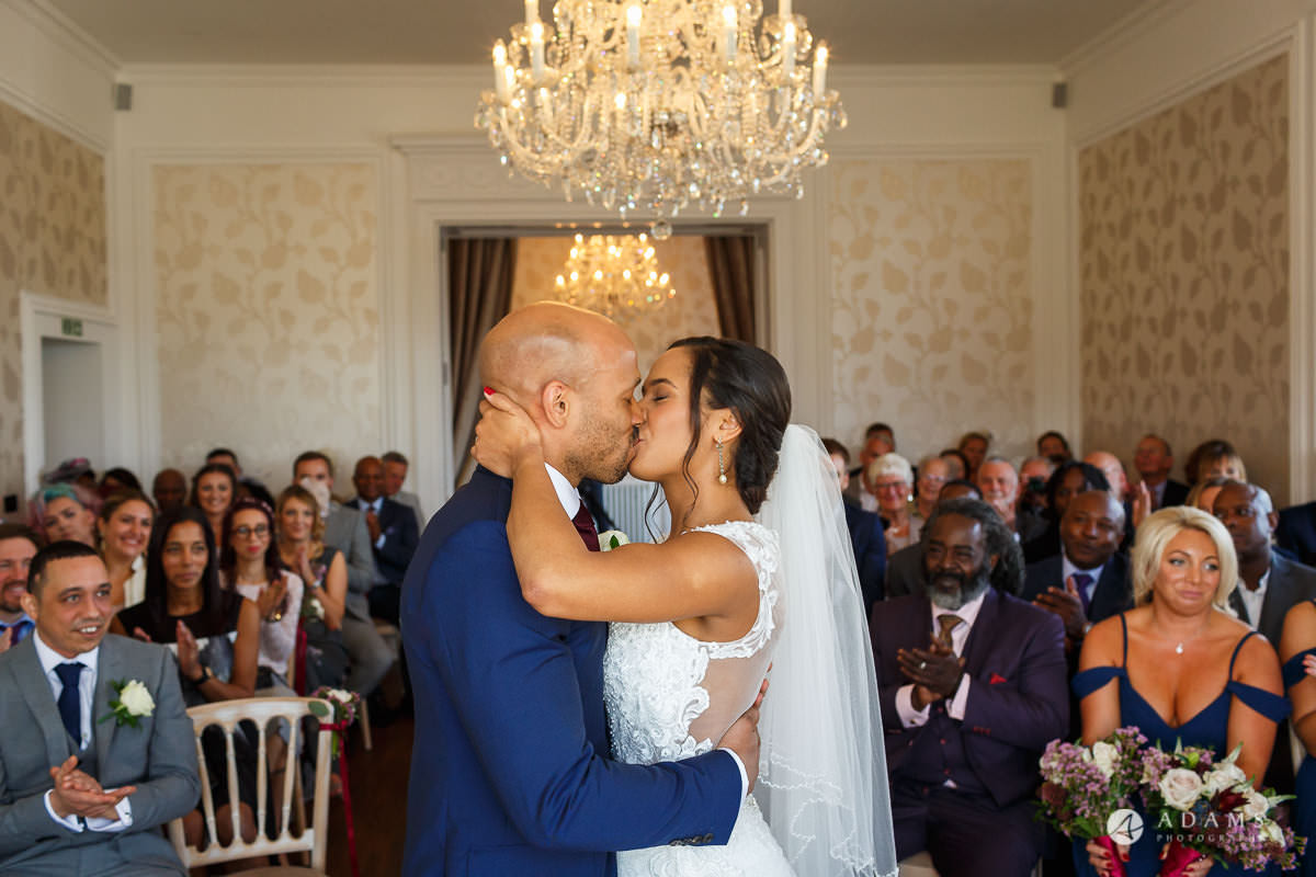 Froyle Park wedding photo of bride and groom first kiss