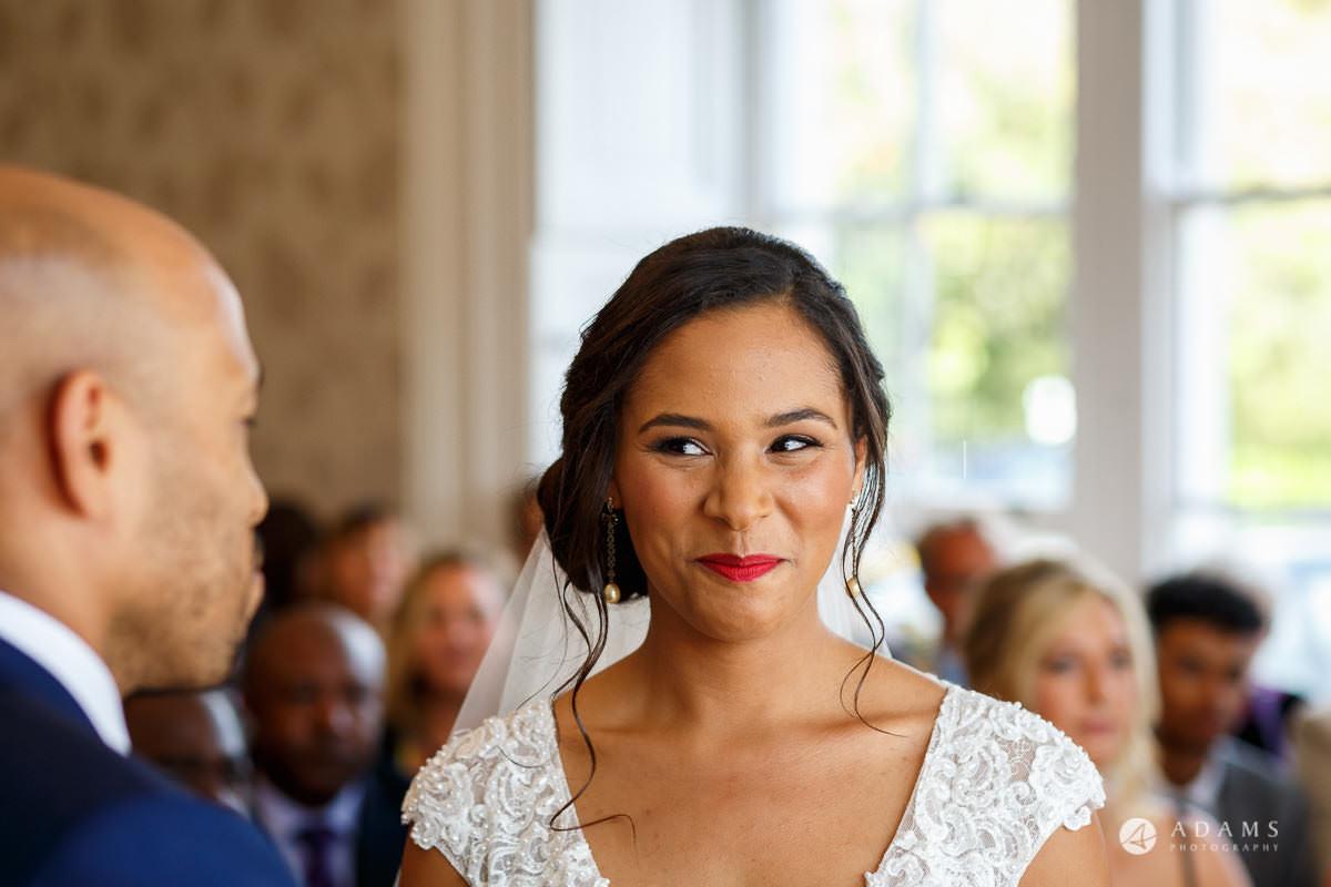 Froyle Park wedding bride glimps on the groom
