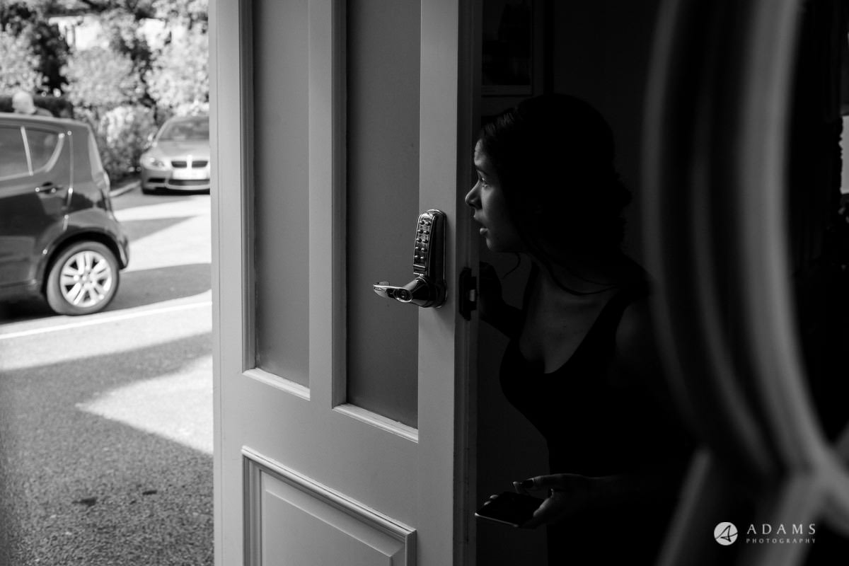 froyle park wedding bride is looking out of the doors