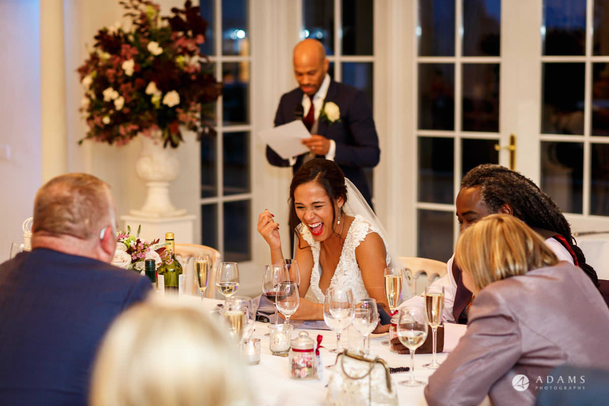 Froyle Park wedding bride laughing at the grooms jokes