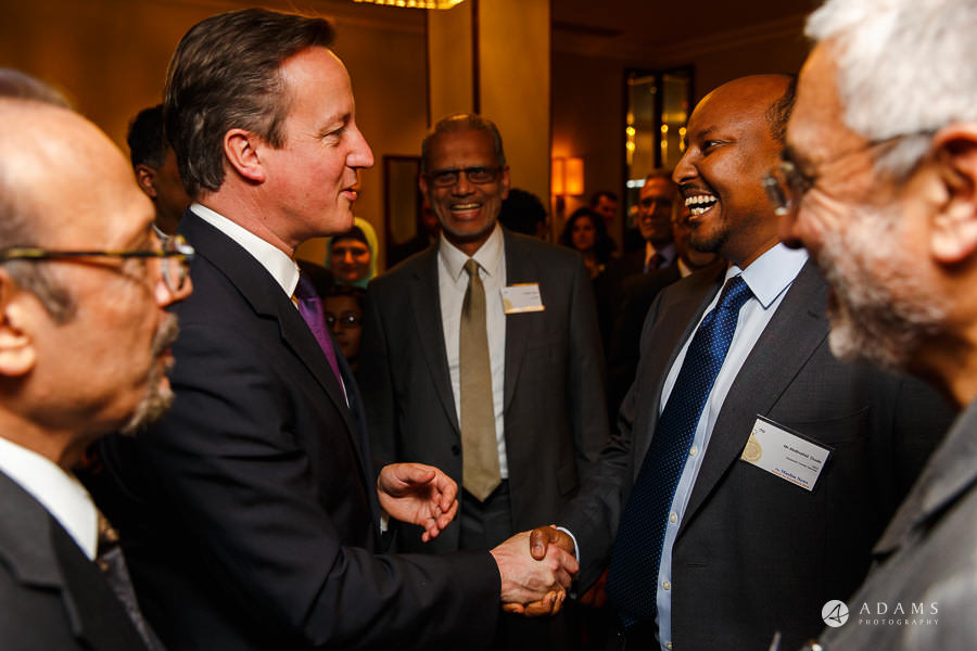 London event photographer David Cameron shaking hands at the conference