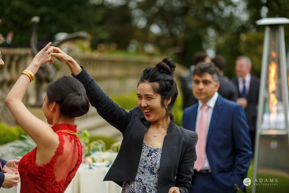 the lost orangery wedding bride dances with a female friend