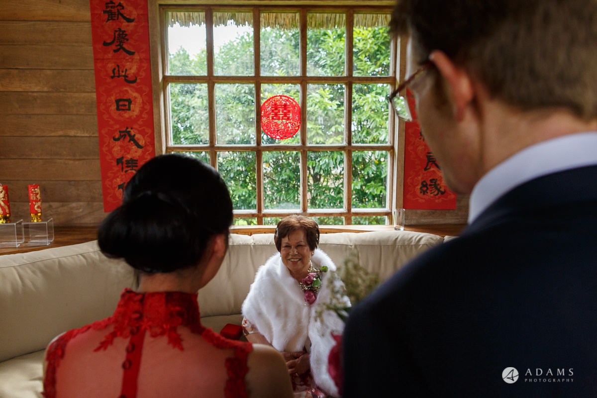 the lost orangery wedding chinese tea ceremony the couple greets the grandmother