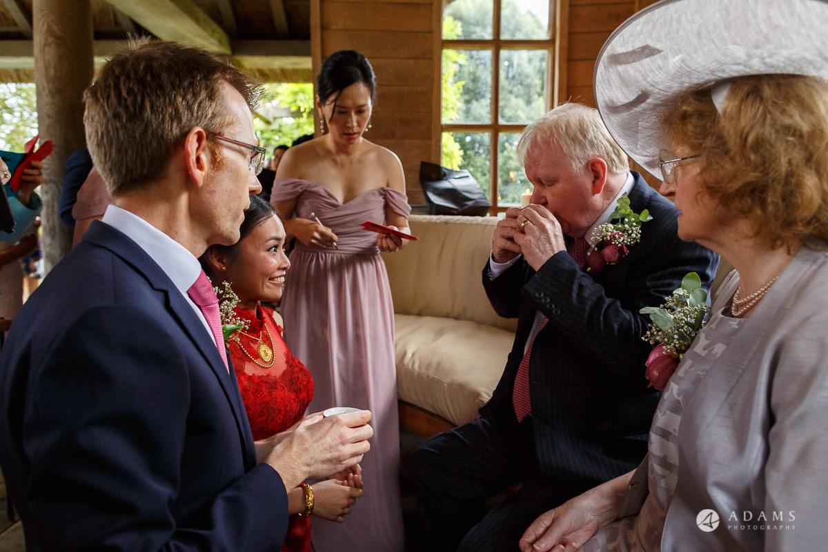 the lost orangery wedding chinese tea ceremony family drinking tea