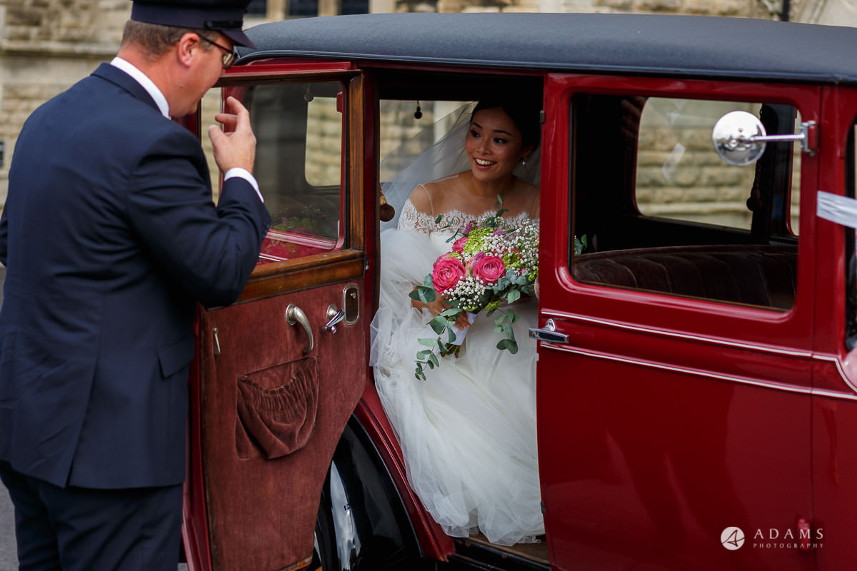 the lost orangery wedding bride arrive in the car