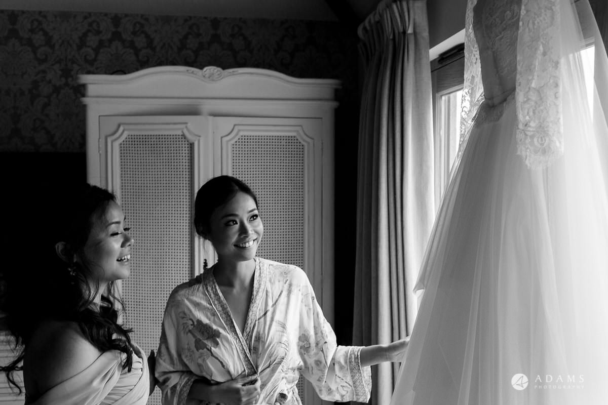tChinese Wedding the lost orangery wedding photography bride looking at her dress
