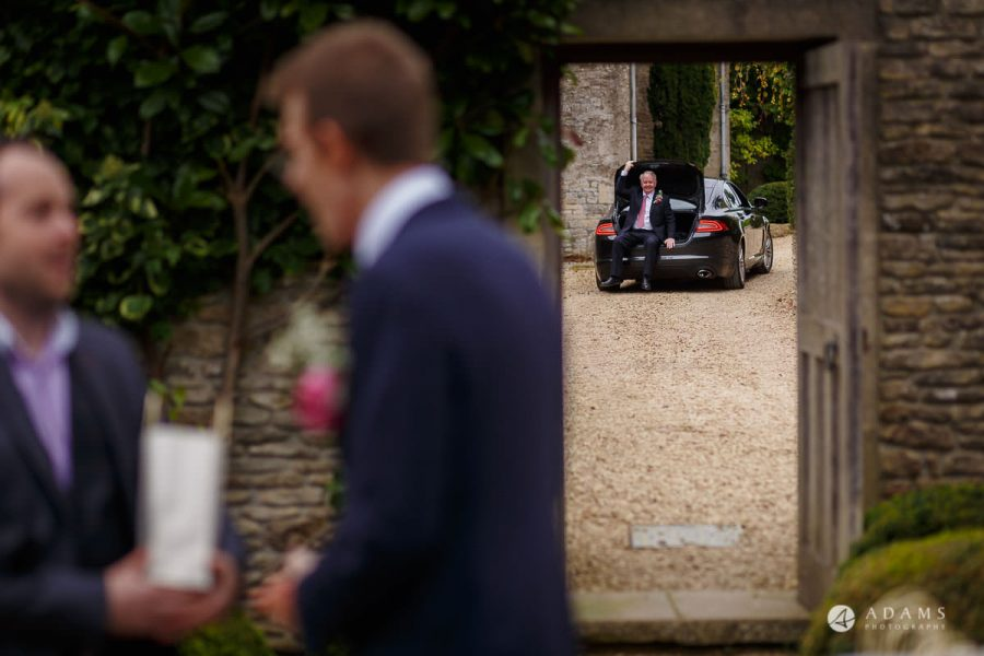 the lost orangery wedding family member sitting in the boot of the car and driving
