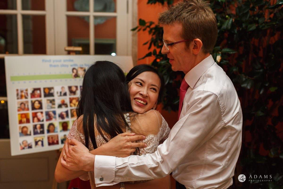 the lost orangery wedding photographer bride and her bridesmaid hug