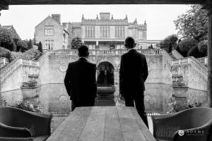 the lost orangery wedding photography groom and his bestman looking at the venue