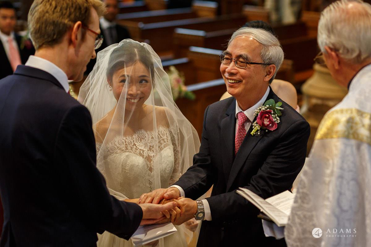 the lost orangery wedding the groom shake hands of the father of the bride
