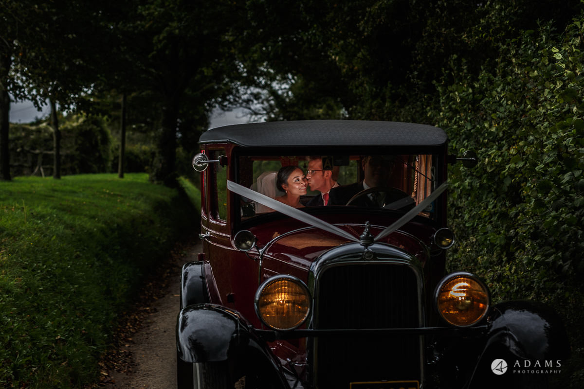 the lost orangery wedding photographer the couple posing in the car