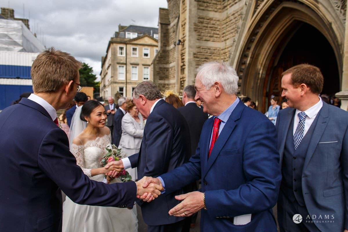 the lost orangery wedding photographer the couple is welcomed by the guests