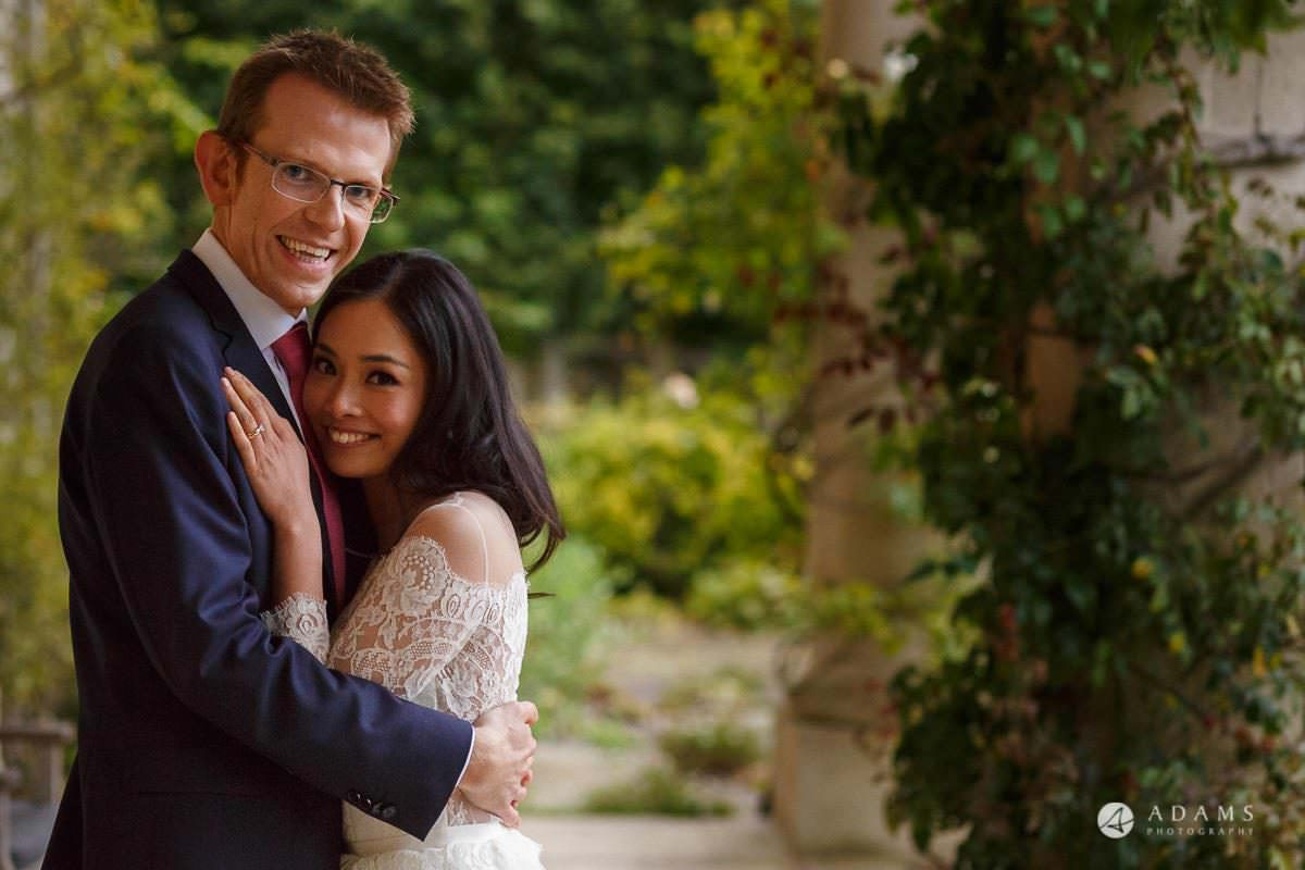 the lost orangery wedding bride and groom posing during the session in a hug