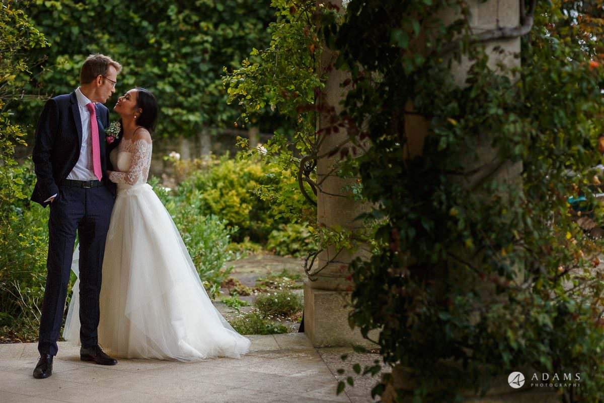 the lost orangery wedding the married couple is about to kiss