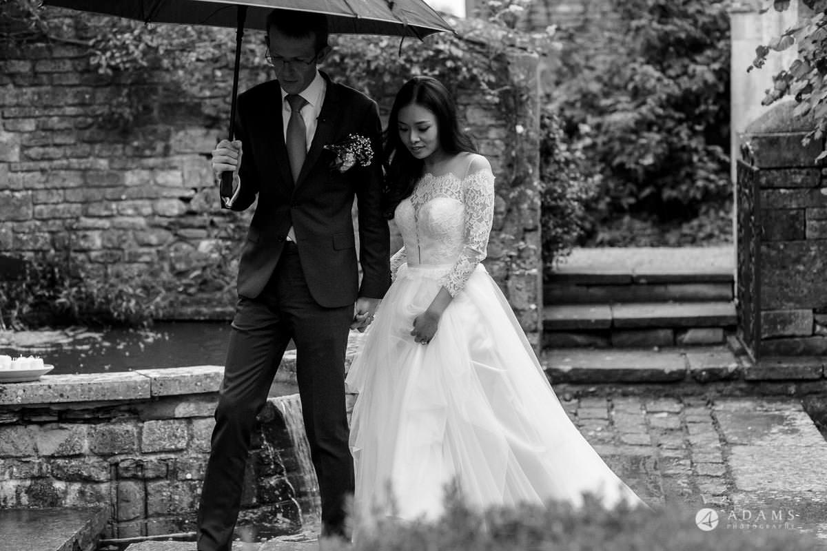 the lost orangery wedding the married couple escaping for a photoshoot