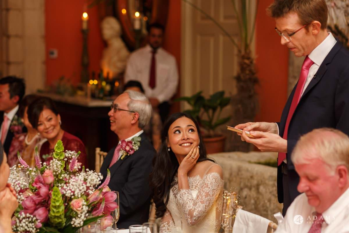 the lost orangery wedding bride looks at groom while he gives his speech