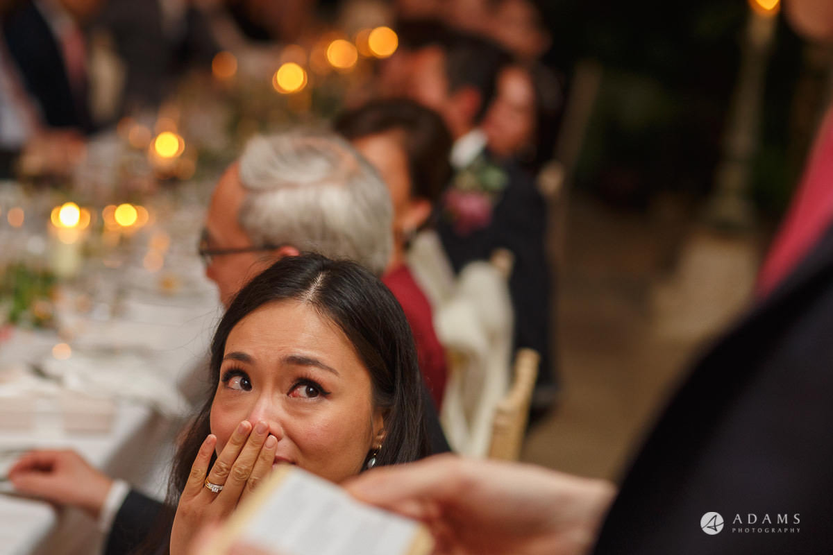 the lost orangery wedding bride gets emotional and is about to cry while the groom gives his speech