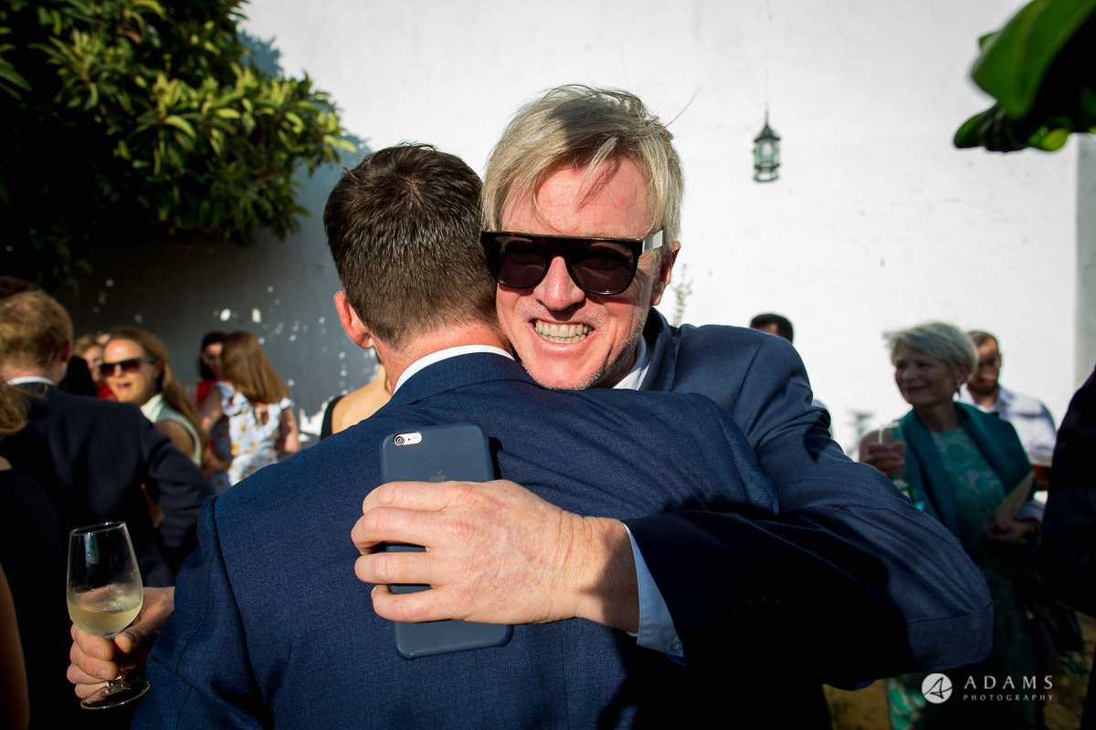 Destination Spain Wedding groom huigs his uncle