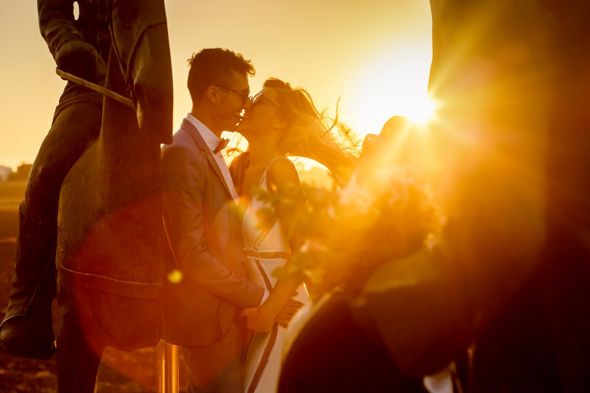 married couple are kissing each other after their wedding in sunny lonond