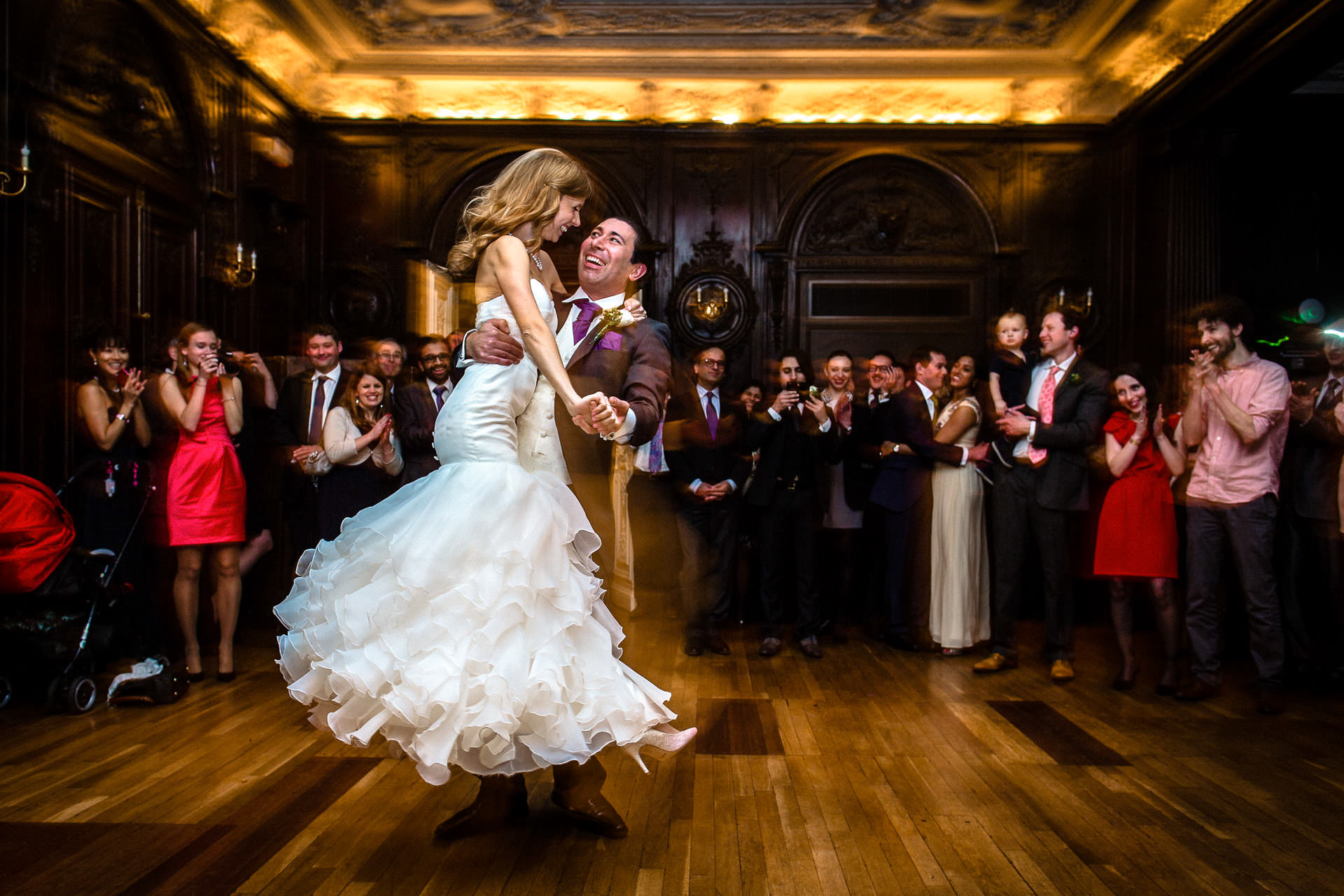 happy couple dancing their first dance at their wedding in central London venue